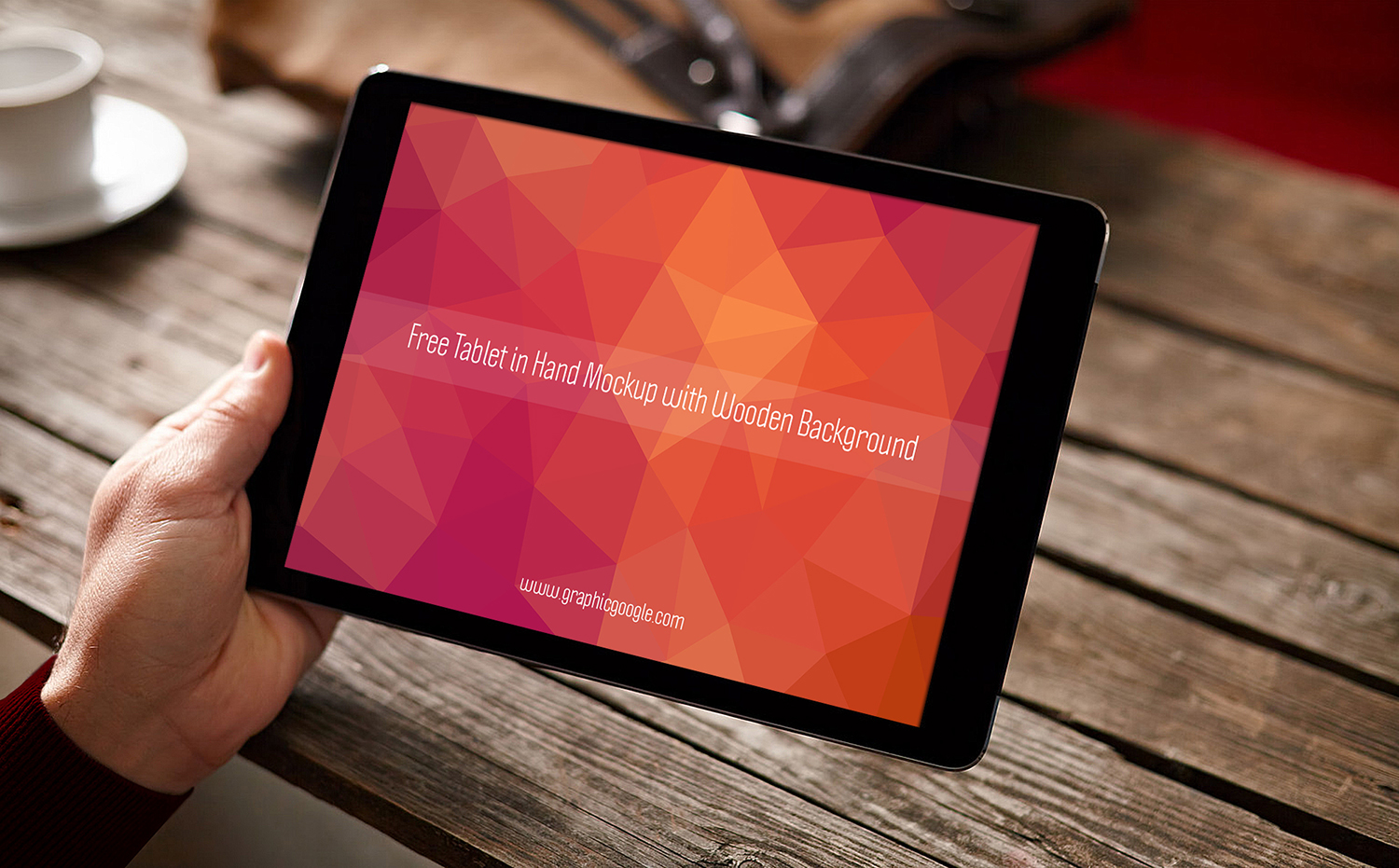 Free Tablet in Hand Mockup with Wooden Background-Preview Image
