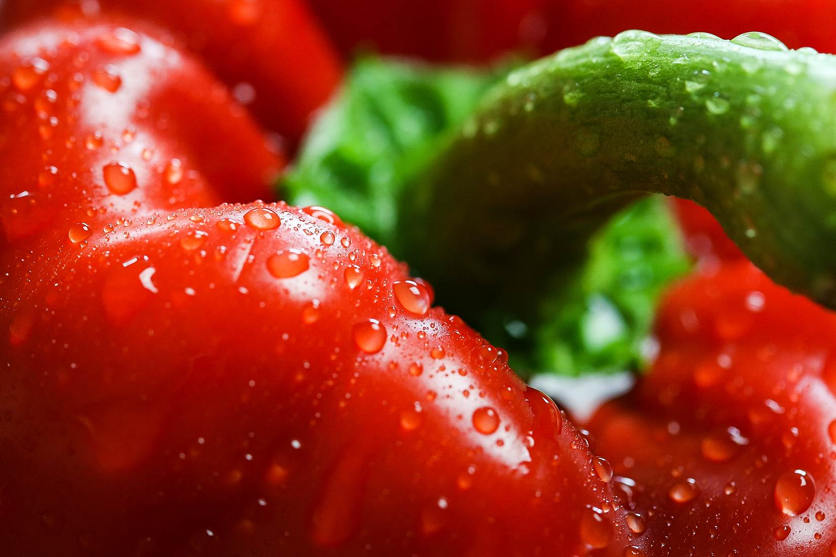 Red Paprika with Drops Close Up Stock Photo