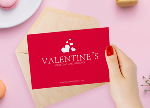 Free-Valentines-Greeting-Card-in-Girl-Hand-Mockup-2018.jpg