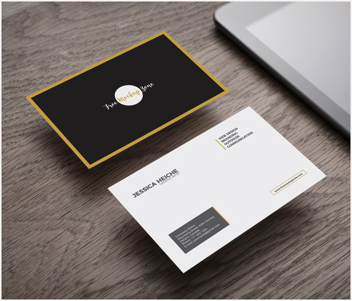 Free-Business-Card-on-Wooden-Table-Mockup