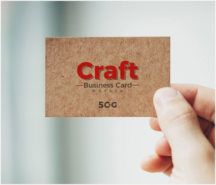 Free-Man-Holding-Craft-Business-Card-Mockup-PSD-2018