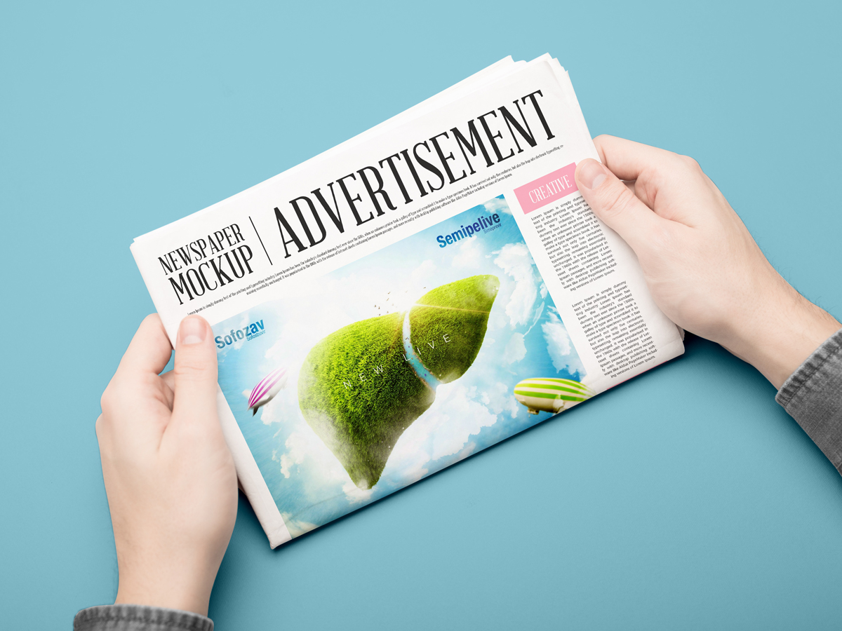 Free-Advertisement-Newspaper-Mockup-PSD-2018