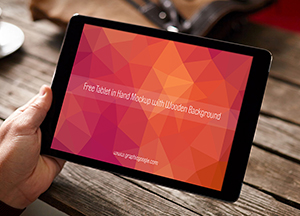 Free Tablet in Hand Mockup with Wooden Background
