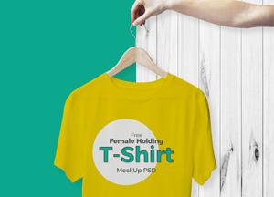 Free-Female-Holding-T-Shirt-Mockup-PSD-2017.jpg