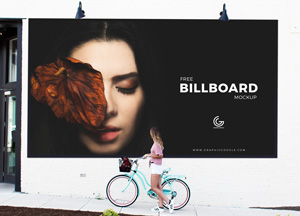 Free Outdoor Girl Watching Billboard Mockup PSD